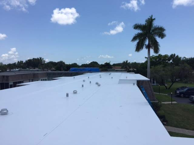 Commercial roofing TPO roof over for a condo unit in Bradenton, FL